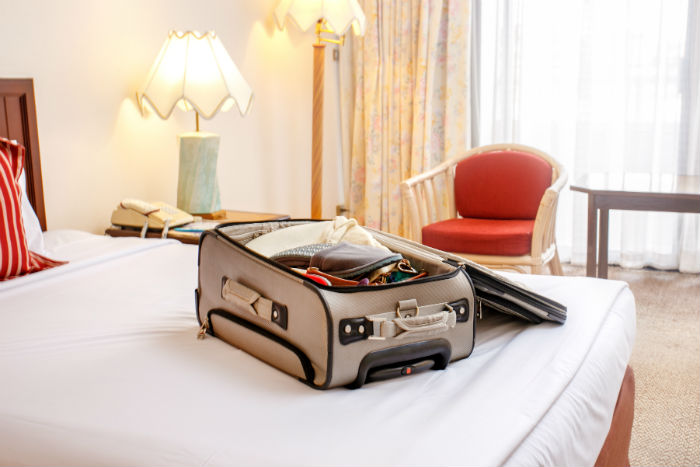 Luggage Bag In Hotel Room