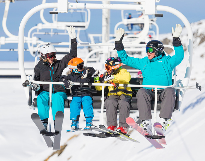 Skiiers On Ski Lift