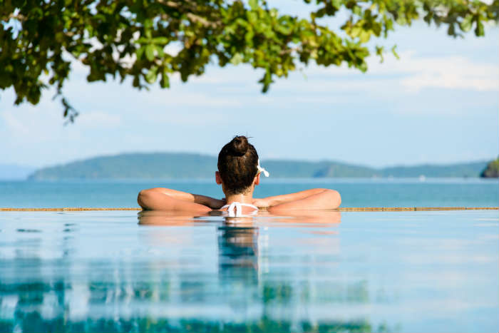 Woman Relaxing In Thailand Pool