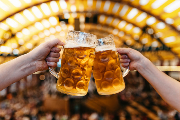 Two People Drinking Beer At Oktoberfest