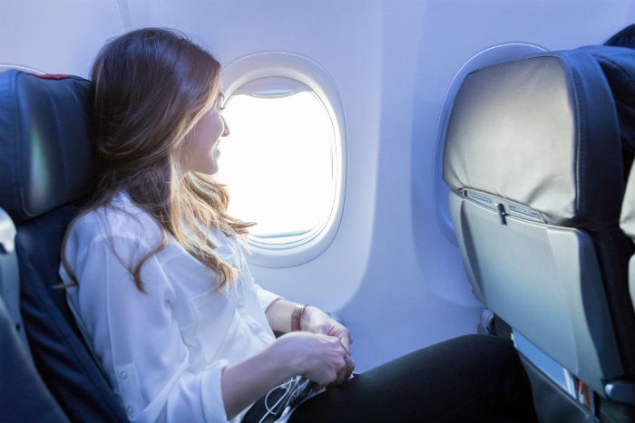 Woman Sat On Aeroplane Window Seat