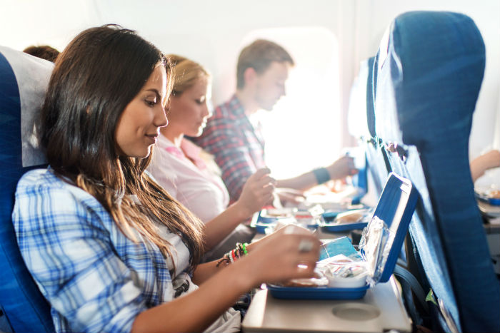 Passengers Eating On Plane