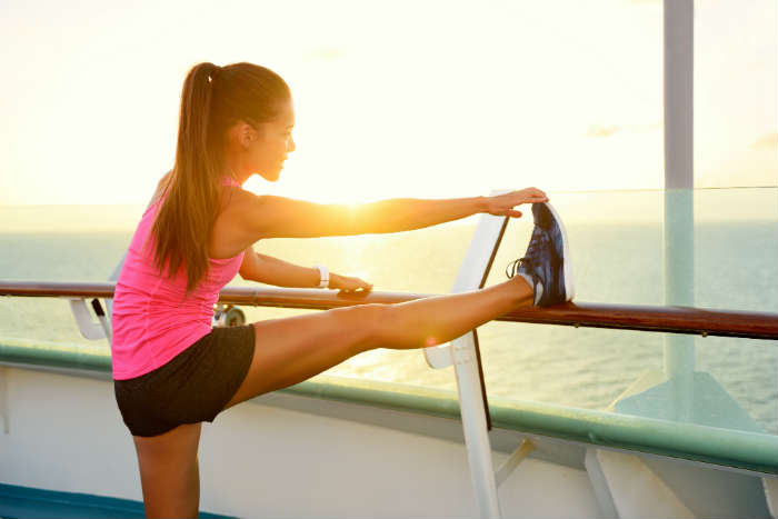 Woman stretching on cruise ship
