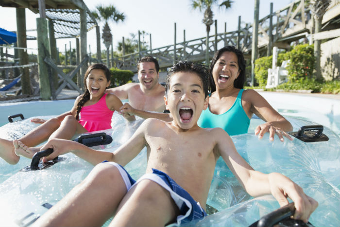 Family On Ride At Water Park