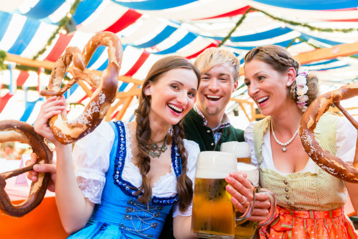 People With Beer And Pretzels At Oktoberfest