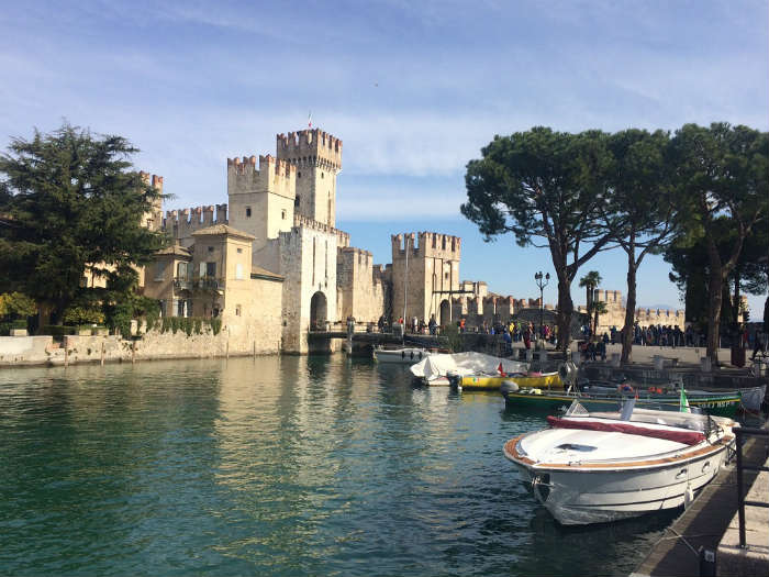 River And Boats In Sirmione