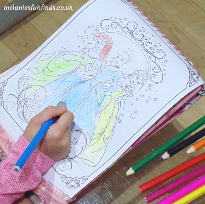 Child Colouring In Colouring Book