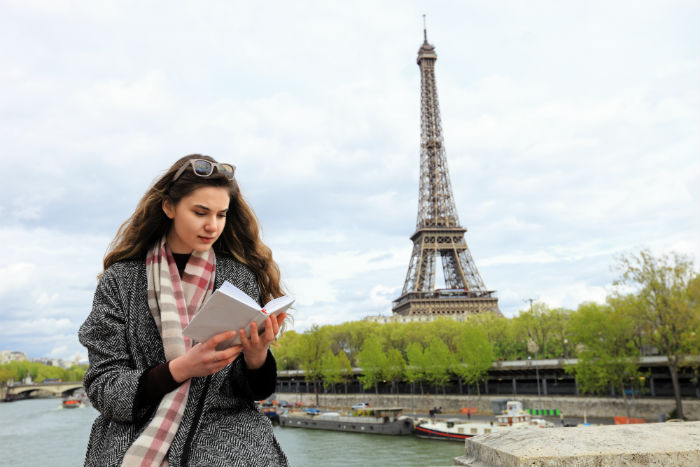 Female With Book In Paris