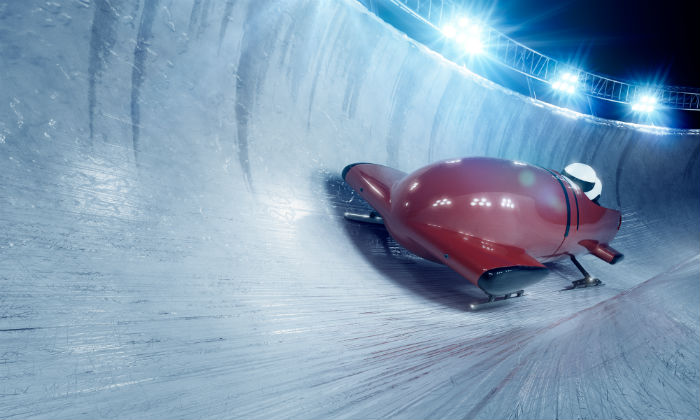 Team Of Bobsleighers On Track