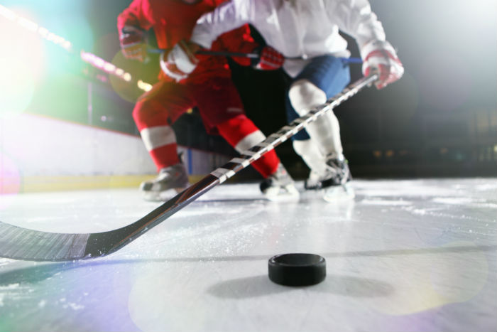 Two People Playing Ice Hockey