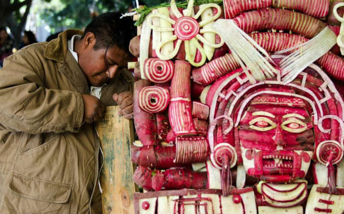 Man Carving Radish Sculpture