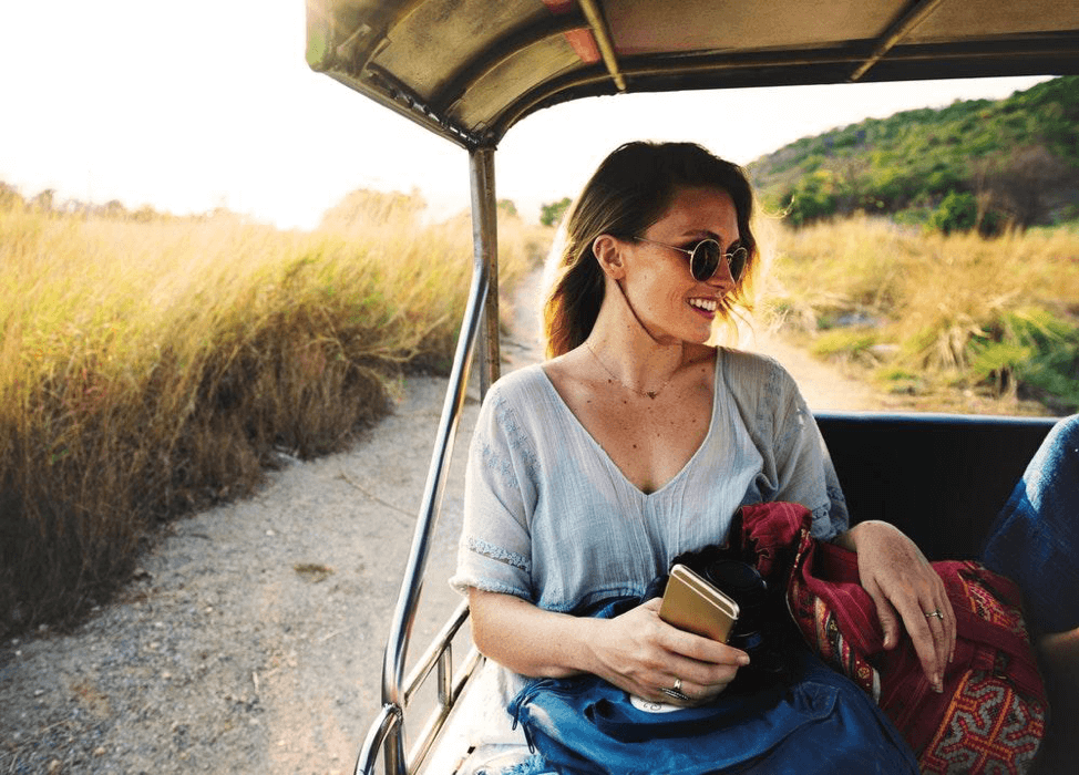 Girl travelling on a long road in an exotic destination