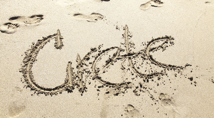 cliche holiday photos-writing in the sand