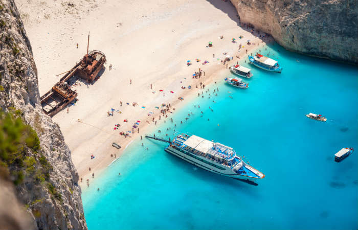 Boats moored at Navagio Beach