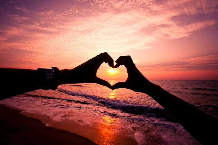 Heart surrounding a sunset on the beach