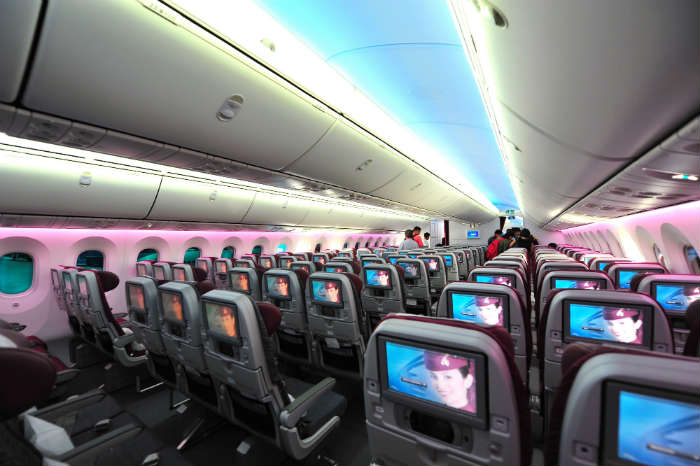 Plane interior with entertainment centres