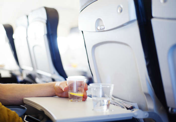 Drinking water on plane
