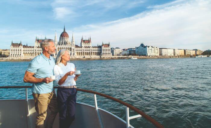 Couple looking out at a lovely view from river cruise ship