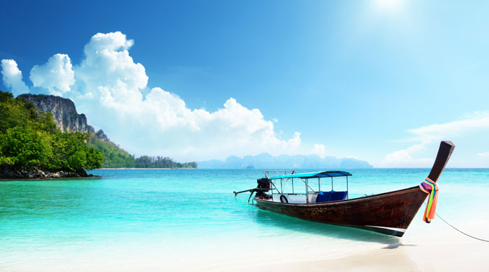 Deserted beach and boat in Thailand