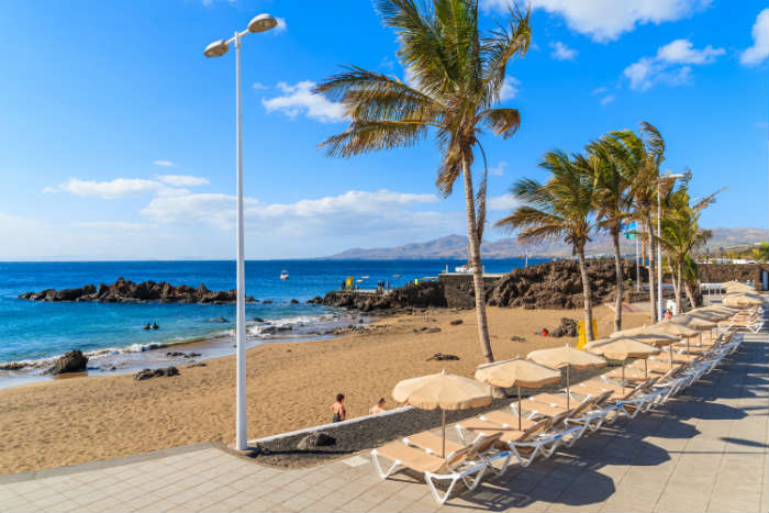 Sunbeds on beach at Puerto del Carmen, Lanzarote
